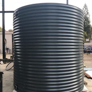 Large grey corrugated water tank