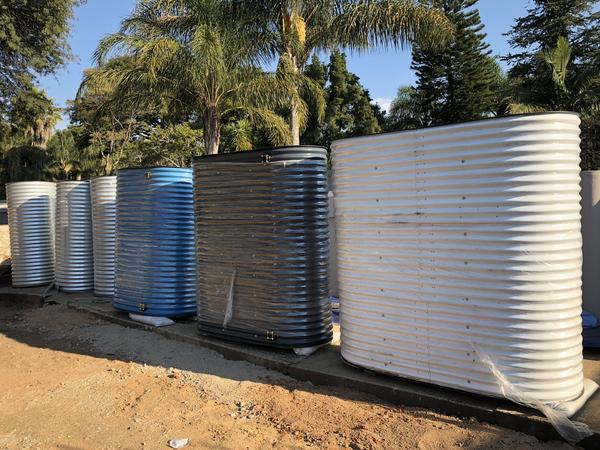 Collection of corrugated water tanks